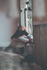 A depressed girl sitting alone and know how to get over someone you love